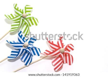 Toy windmills on white background (1) - stock photo