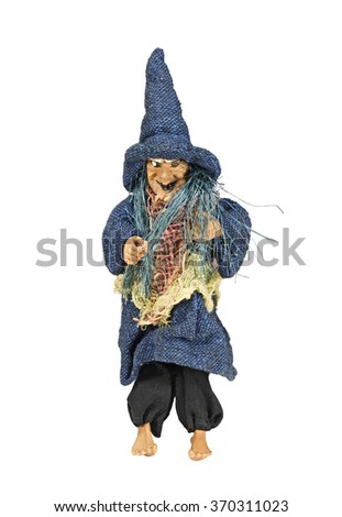 Toy witch in hat isolated on white background - stock photo