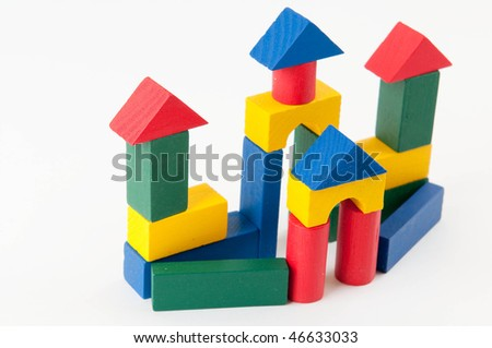 Toy wooden castle on white background - stock photo