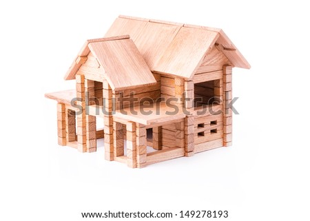 Toy wooden house isolated. Building, construction concept. - stock photo
