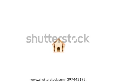 toy wooden model house as symbol family and love concept  on sunnyon white background, isolate, buying a house, mortgage, repair, stability,  - stock photo