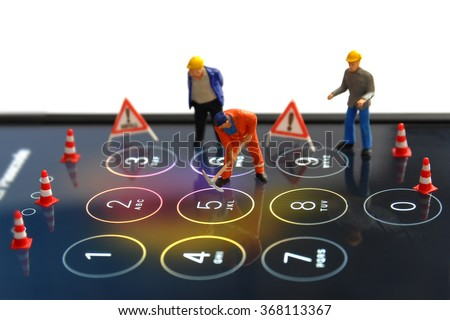 Toys hacker concept with mobile touch screen number - stock photo