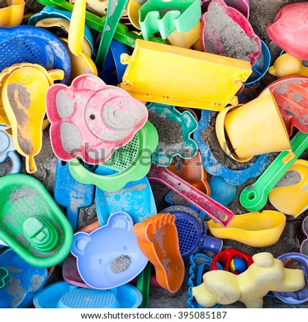 Toys in sandbox - stock photo