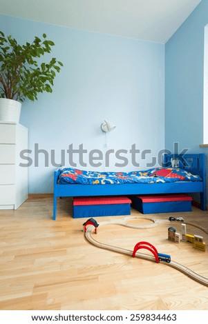 Toys left on wooden floor in small children room - stock photo