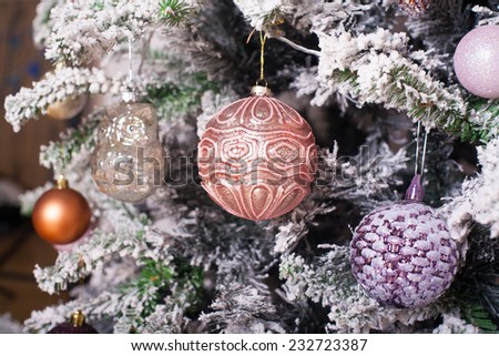 Toys on the Decorated Christmas tree - stock photo