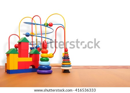 toys on the floor in a playroom - stock photo