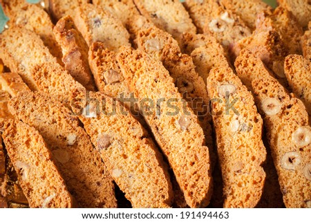 Tozzetti are traditionally Italian oblong-shaped almond biscuits, made dry and crunchy through cutting the loaf of dough while still hot and fresh from baking in the oven.  - stock photo