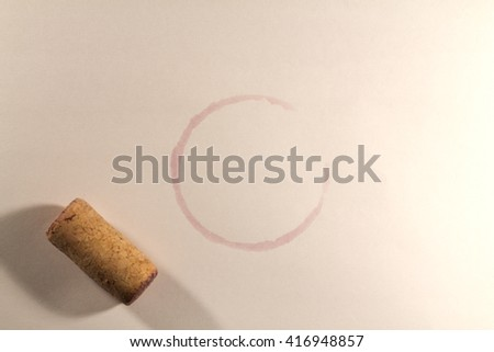 trace from glasses of wine on a white tablecloth - stock photo