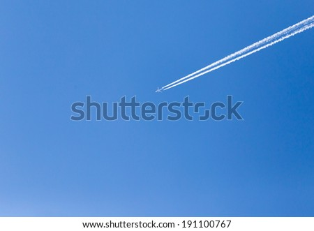 trace of an airplane in the blue sky - stock photo