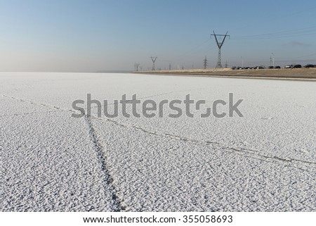 Trace on a surface of the river covered with snow,  River Ob, Russia - stock photo