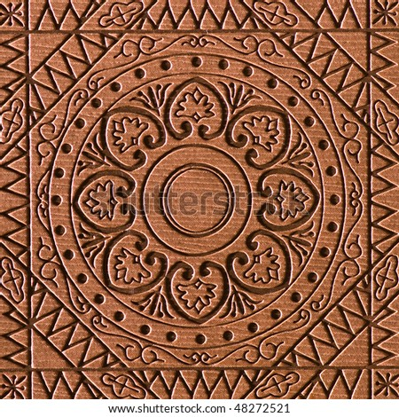 Tracery on brown leather - stock photo