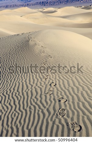 Traces a boot on sand. Sand Dune . National park Death valley - stock photo
