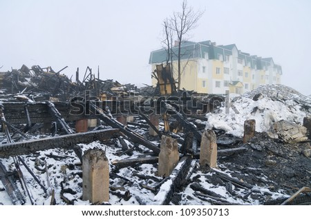 Traces of fire with a newly built house in the background - stock photo