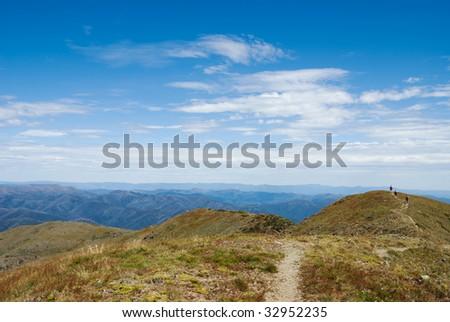 Track along ridge of Mt Feathertop, Victoria, Australia, in summer - stock photo