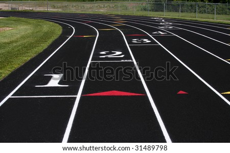 Track and field lanes. - stock photo