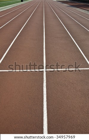 Track and field lanes in a stadium. - stock photo
