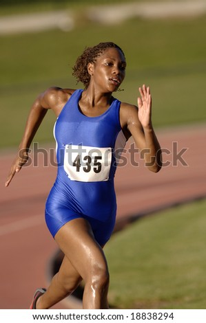track athlete running in competition - stock photo