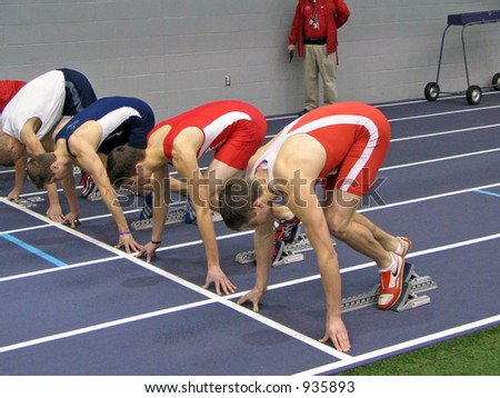 Track Athletes in Starting Blocks - stock photo