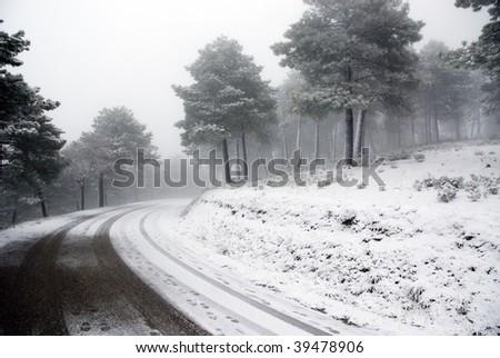 Track car on a snowy landscape - stock photo