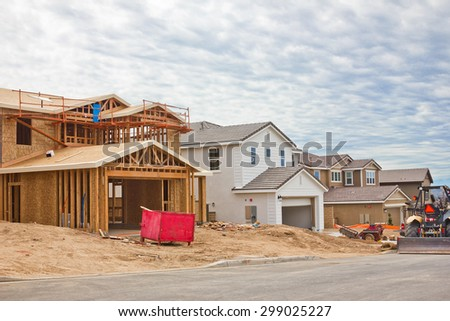 Track homes completed and incomplete on a construction site.  - stock photo