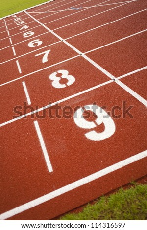 track number, track numbers on red rubber racetracks - stock photo