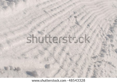 track of snowcat on ski slope - stock photo