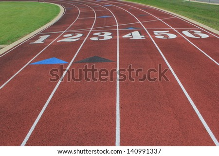 track with 6 lanes approaching the curve - stock photo