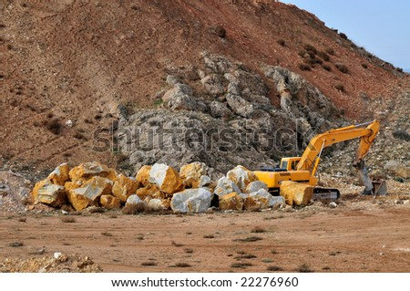 tracked excavator on landfill and heavy machinery - stock photo