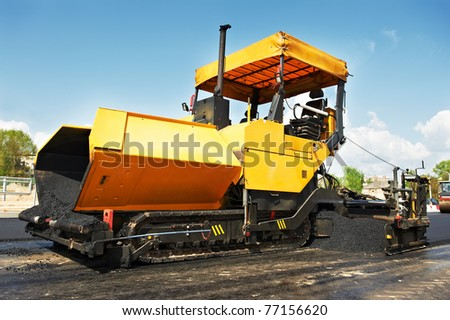 tracked paver at asphalt pavement works for road repairing - stock photo