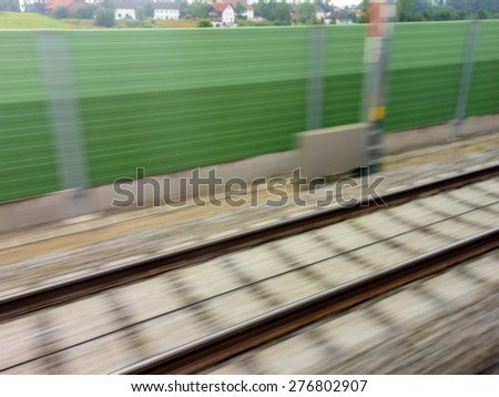 tracks and rails out in movement from a moving train. symbolic photo for train, tempo and dynamics. - stock photo