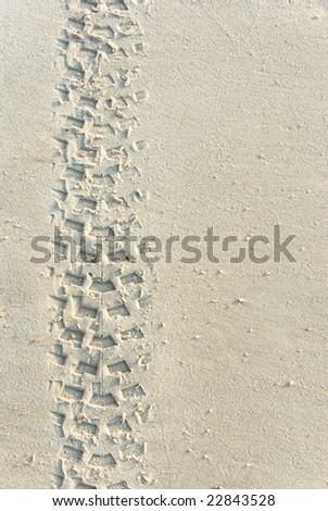 tracks on a beach - stock photo