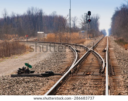 Tracks switching direction to Detroit destination - stock photo