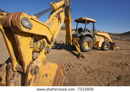 Tractor at a Construction Site and dirt lot. - stock photo