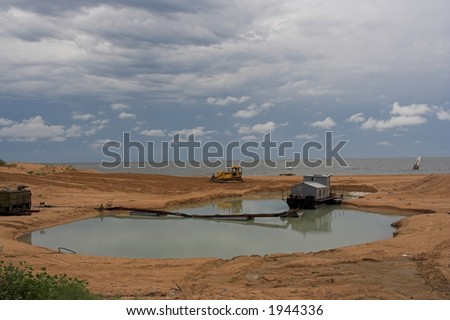 Tractor at the beach - stock photo