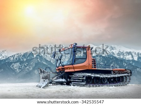 Tractor cleaning snow outdoors - stock photo