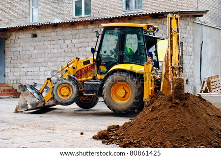 tractor digging a trench - stock photo