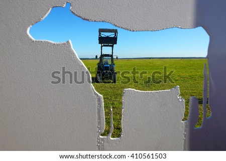 Tractor in a farmer field.Background of agriculture industry - stock photo