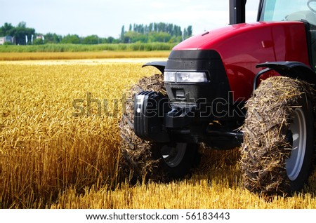 Tractor in a field, an exhibition of modern technology - stock photo