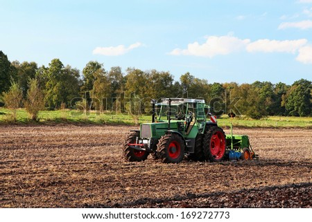 Tractor on field - stock photo