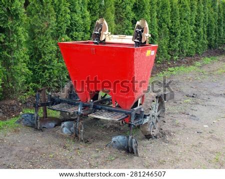 Tractor powered two furrow potato planter rear view      - stock photo