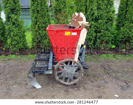 Tractor powered two furrow potato planter side view - stock photo