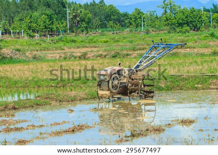 Tractor walk - is Thailand's major rice farmers always -12 July 2015. - stock photo