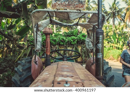 Tractor with green banana - stock photo