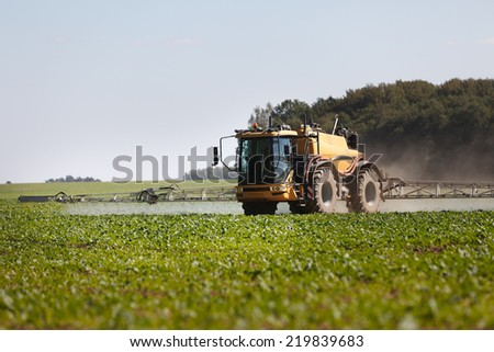 Tractor with pesticide fungicide insecticide sprayer - stock photo