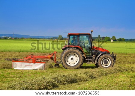 Tractor with rotary rakes - stock photo
