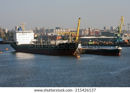 Trade ships at the sea port - stock photo