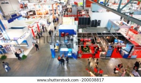 Trade show background, blurred post production - stock photo