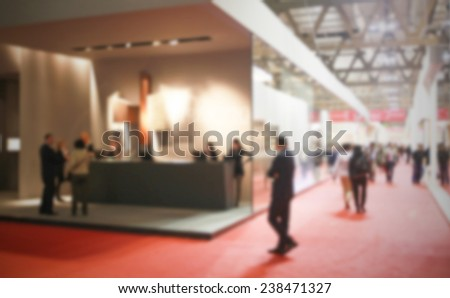 Trade show exhibition, generic background. Intentionally blurred post production. - stock photo