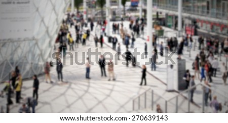 Trade show people generic background. Intentionally blurred editing post production. - stock photo