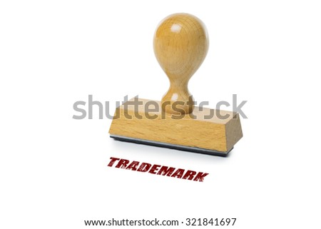 Trademark printed in red ink with wooden Rubber stamp isolated on white background - stock photo